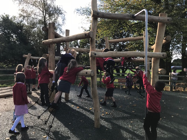 school children on a climbing frame